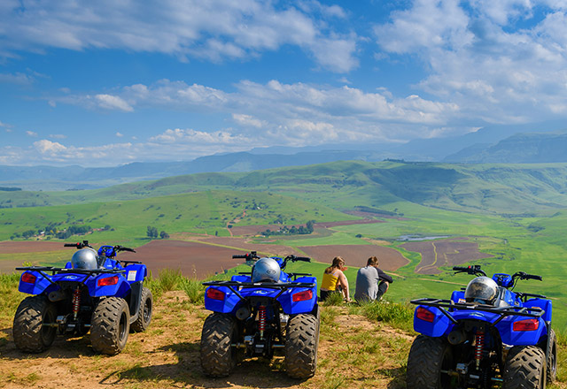 Quad bikes overlooking a valley